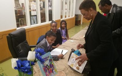 8th grader Julian R. Johnson autographs his first book – Family Movie Night Excitement with The Popsicle Kids!